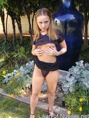 seductive teen poses outside