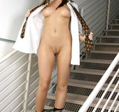 Smokin teen in a shirt and tie shows all on stairs