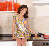 Hot Nubile Henessy fucks herself in the kitchen using a spatula