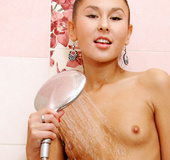 Olive skinned Asian Nubile plays with her needy pussy in the shower