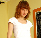 Tall slender red head fingers herself at Nubiles