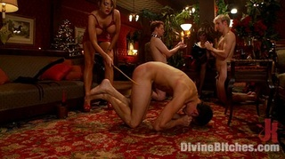 latex dressed dominatrixes spank