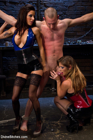 Two adorable busty dominatrixes in sexy  - Picture 4