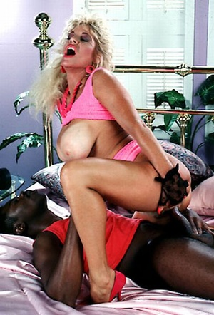 Big titted seventies lady loves a black  - Picture 8