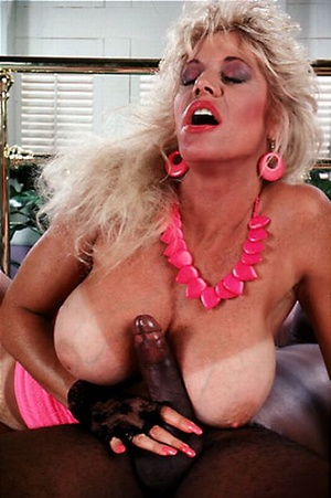 Big titted seventies lady loves a black  - Picture 11