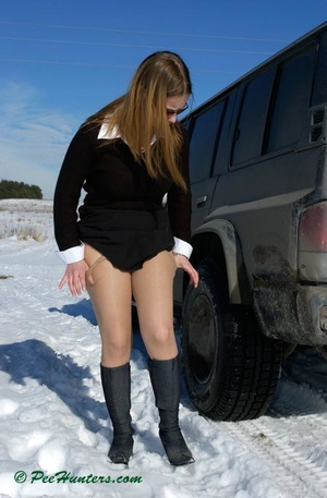 Teen peeing on snow near the car - XXXonXXX - Pic 4