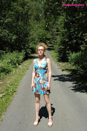 Teeny pissing in the middle of the country road - XXXonXXX - Pic 3