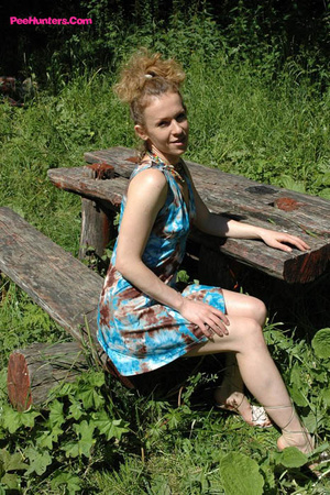 See hot teeny pissing onto her dad's picnic table - XXXonXXX - Pic 1