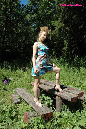 See hot teeny pissing onto her dad's picnic table - XXXonXXX - Pic 2