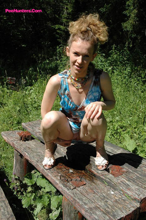 See hot teeny pissing onto her dad's picnic table - XXXonXXX - Pic 13