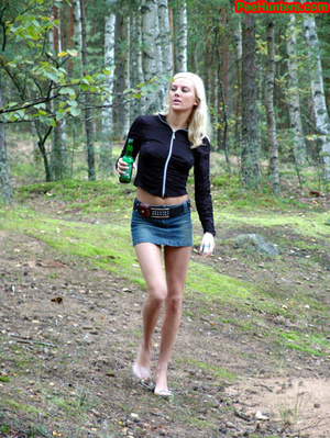 Exciting blonde teen peeing in the park - XXXonXXX - Pic 2