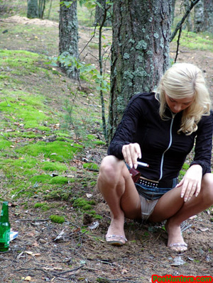Exciting blonde teen peeing in the park - XXXonXXX - Pic 7