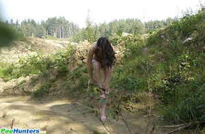 Delicious naked brunette takes a leak in the bush - XXXonXXX - Pic 11