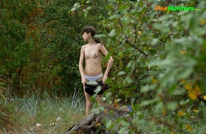 Slim teenage nudist chick caught peeing in bush - XXXonXXX - Pic 3