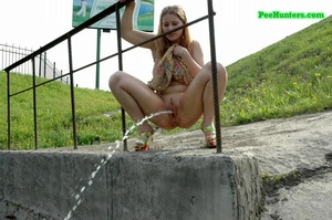 Teenage doll taking a long piss off the bridge - XXXonXXX - Pic 9