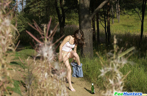 Beautiful kitty plays watersports on a quiet forest glade - XXXonXXX - Pic 6