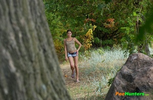 Young swarthy babe pisses sitting on the rock - XXXonXXX - Pic 1