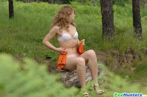 Kinky beauty makes piddle while sitting on a log - XXXonXXX - Pic 8