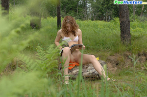 Kinky beauty makes piddle while sitting on a log - XXXonXXX - Pic 11