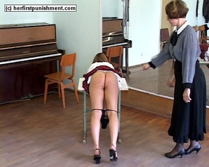 Piano teacher gives her student a good s - Picture 10