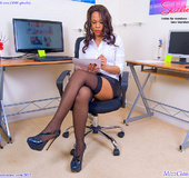 Sexy shaped ebony secretary in black stay ups exposing her pink wet pussy.