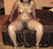 Shaved pussy indian plumper slips out her sexy pink lingerie.