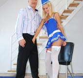 Blonde blue-dressed air hostess inviting the captain of her aircraft to