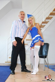 blonde blue-dressed air hostess