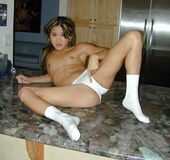 In her cheerleader outfit, Eurasian Kitty is every guy's wet dream