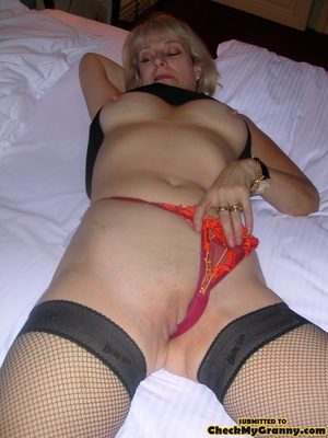 Blonde mature stunner teasingly changing - XXX Dessert - Picture 9