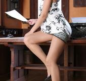 Hot brunette in high heels demonstrates her delights in the office