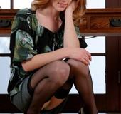 Hot secretary posing on cam and undresses