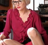 Blonde slut in high heels undresses and demonstrates her shaved cooch