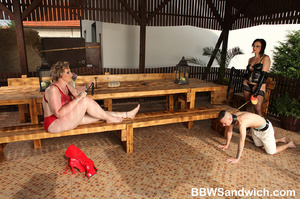 Two fat mistresses in latex enslaves a g - XXX Dessert - Picture 1