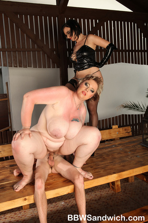 Two fat mistresses in latex enslaves a g - XXX Dessert - Picture 13