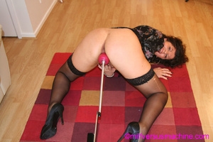 Horny milf in black stockings gets her c - Picture 3