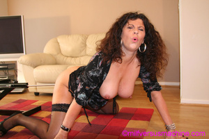 Horny milf in black stockings gets her c - Picture 15