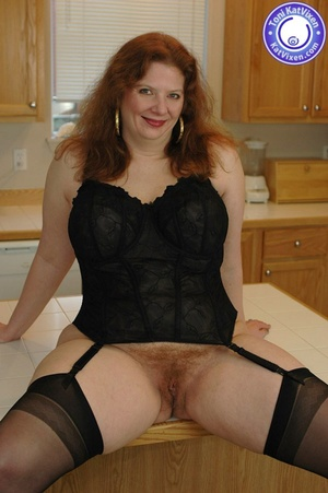 Horny redhead lays on the kitchen table  - XXX Dessert - Picture 1