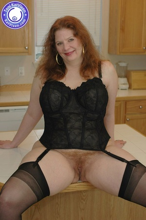 Horny redhead lays on the kitchen table  - XXX Dessert - Picture 2