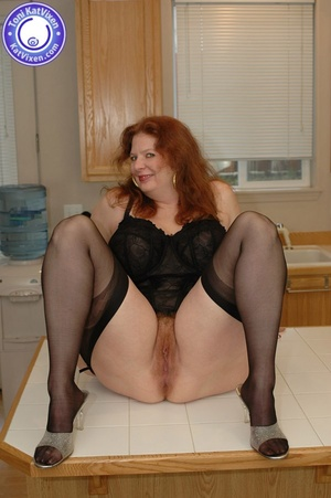 Horny redhead lays on the kitchen table  - XXX Dessert - Picture 8