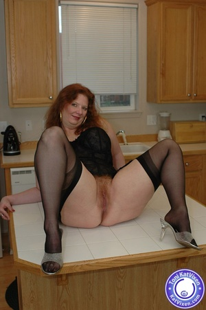 Horny redhead lays on the kitchen table  - XXX Dessert - Picture 10