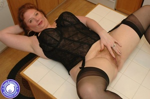 Horny redhead lays on the kitchen table  - XXX Dessert - Picture 16