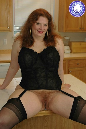 Busty redhead in some sexy black lingeri - XXX Dessert - Picture 1