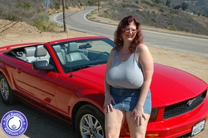 Hot Toni KatVixen posing by a red car - XXX Dessert - Picture 1