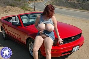 Hot Toni KatVixen posing by a red car - XXX Dessert - Picture 11