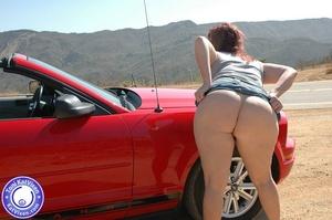 Hot Toni KatVixen posing by a red car - XXX Dessert - Picture 16