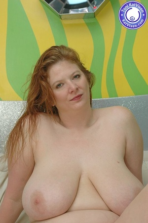 Busty redhead holding her big boobs - XXX Dessert - Picture 2