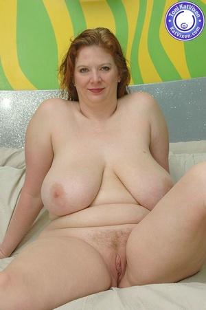 Busty redhead holding her big boobs - XXX Dessert - Picture 3