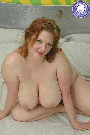 Busty redhead holding her big boobs - XXX Dessert - Picture 12
