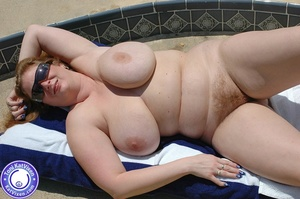 Big breasted redhead sunbathing by the p - XXX Dessert - Picture 2